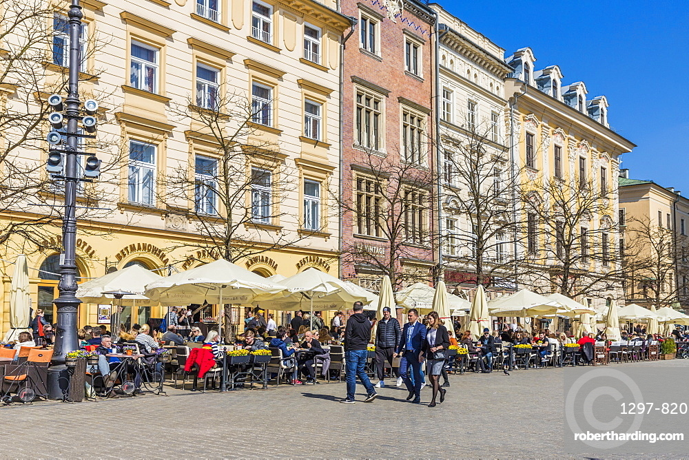 A cafe scene in the main square, Rynek Główny, in the medieval old town a UNESCO World Heritage site, in Krakow, Poland, Europe.