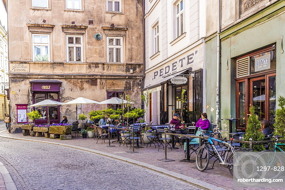A cafe scene in the medieval old town, a UNESCO world Heritage site, in Krakow, Poland, Europe.