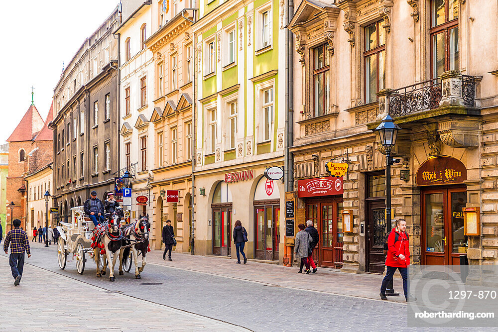 A horse drawn carriage in the medieval old town, a UNESCO World Heritage site, in Krakow, Poland, Europe.