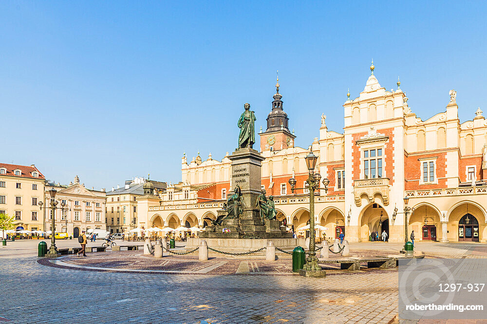 Adam Mickiewicz Monument & Cloth Hall in the main Square in the medieval old town, a UNESCO World site in Krakow, Poland, Europe