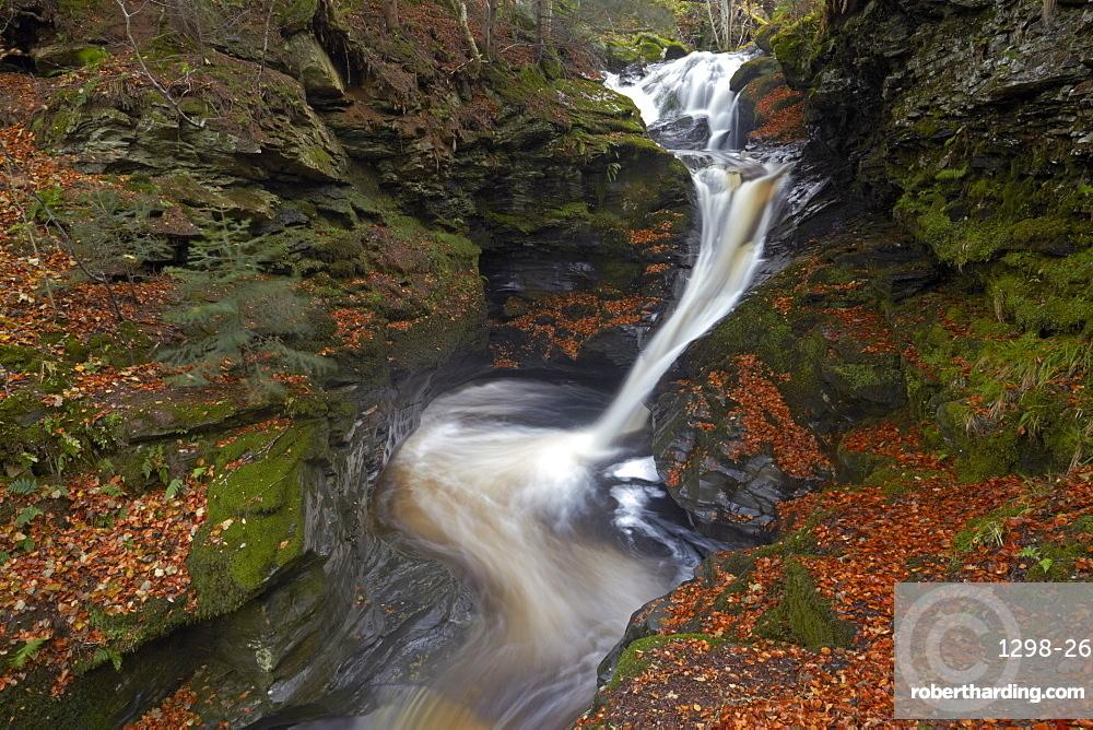 The upper Falls of Acharn near Aberfeldy in late autumn, Perthshire, Scotland, United Kingdom, Europe