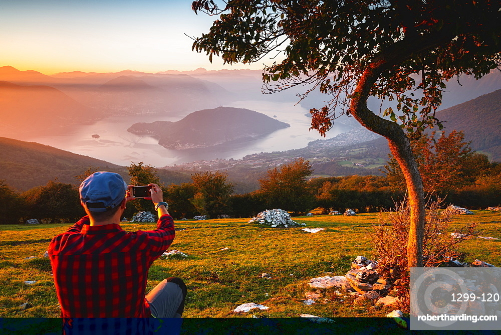 Photographing the Iseo lake and Monte Isola at sunset in autumn season, Lombardy district, Brescia province, Italy, Europe