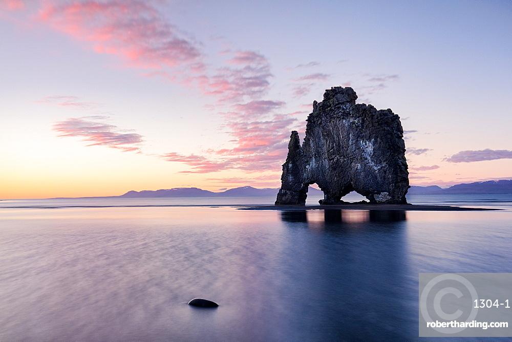 Hvtserkur, a dragon shaped rock in North West Iceland at sunset, around midnight in summer, Iceland, Polar Regions