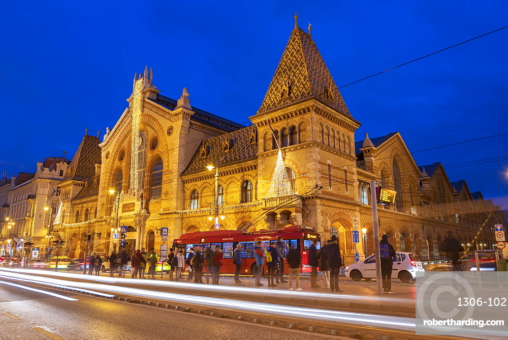 Exterior of Great Market Hall (Central Market Hall) at night with light trails, Kozponti Vasarcsarnok, Budapest, Hungary, Europe