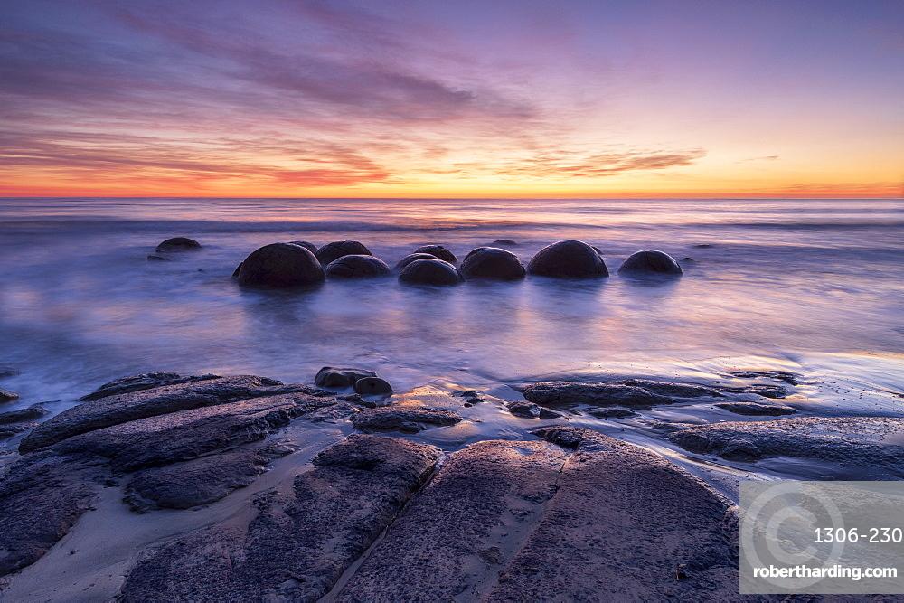 The Moeraki Boulders with incredible sunrise, Moeraki Beach, Otago, New Zealand.