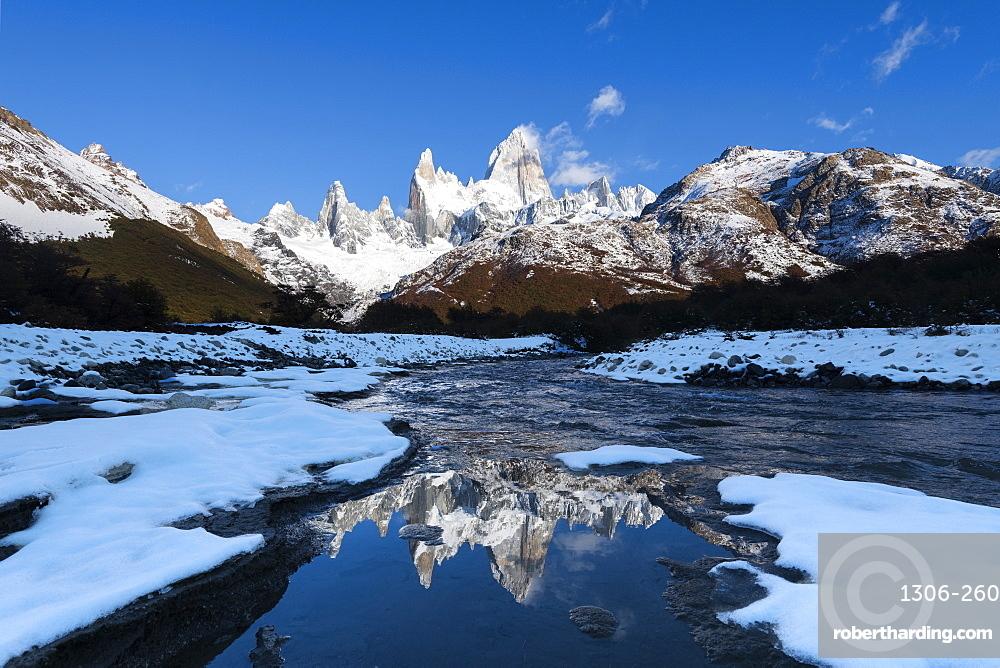Fitz Roy and Cerro Torre in winter conditions at sunrise reflected, Los Glaciares National Park, El Chaltén, Santa Cruz Province, Patagonia, Argentina, South America