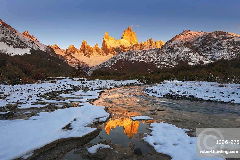 Mountain range with Cerro Fitz Roy at sunrise reflected in river, Los Glaciares National Park, El Chaltén, Patagonia, Argentina,