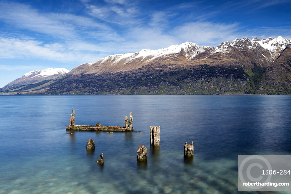 Decayed jetty, old wooden posts in Lake Wakatipu at Glenorchy, Otago Region, Southland, New Zealand