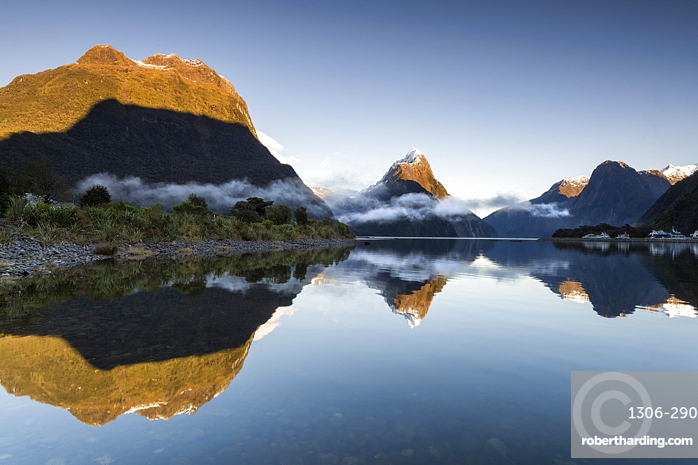 Low cloud lying below Mitre Peak at Milford Sound, Fiordland National Park, New Zealand