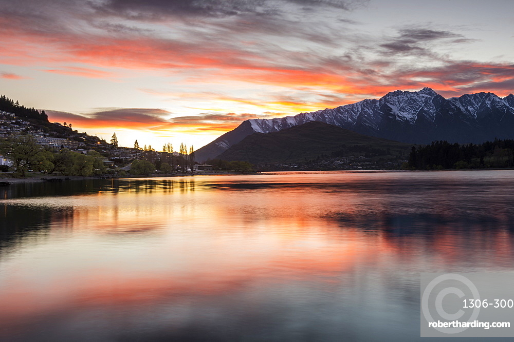 Queenstown and Bob's Peak with red sky at sunrise, South Island, New Zealand