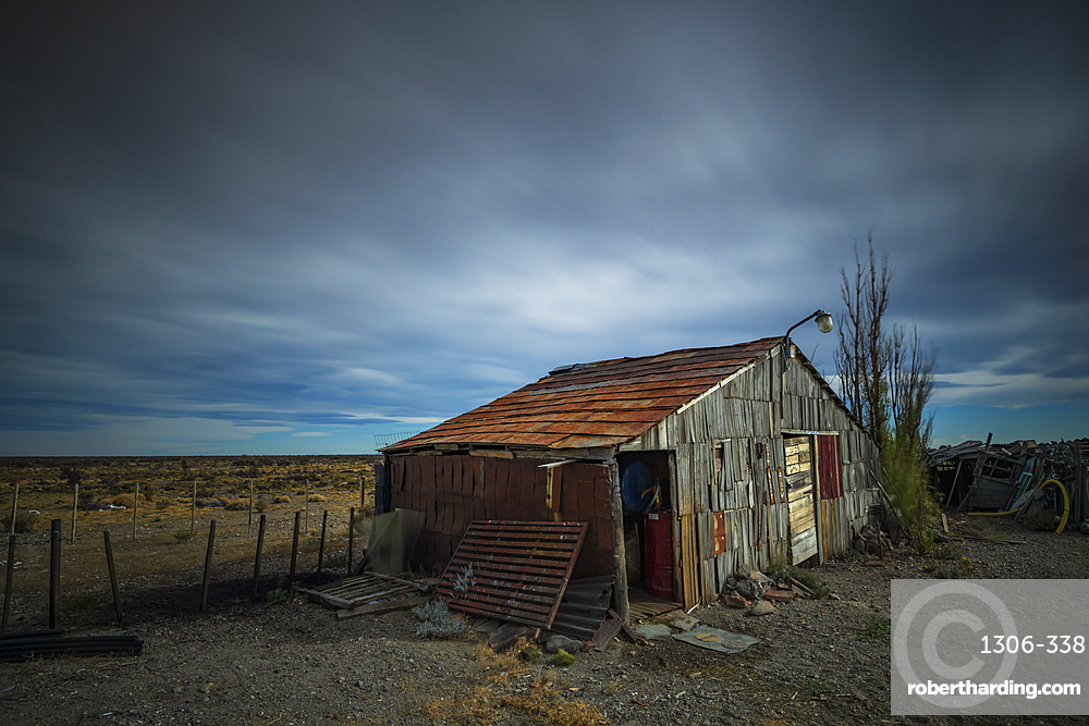 Old shed set against open landscape in Patagonia, Argentina, South America.