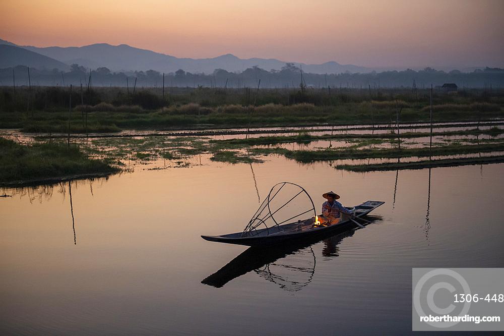 Intha leg rowing fisherman at Inle Lake gardens, Inle Lake, Shan State, Myanmar.