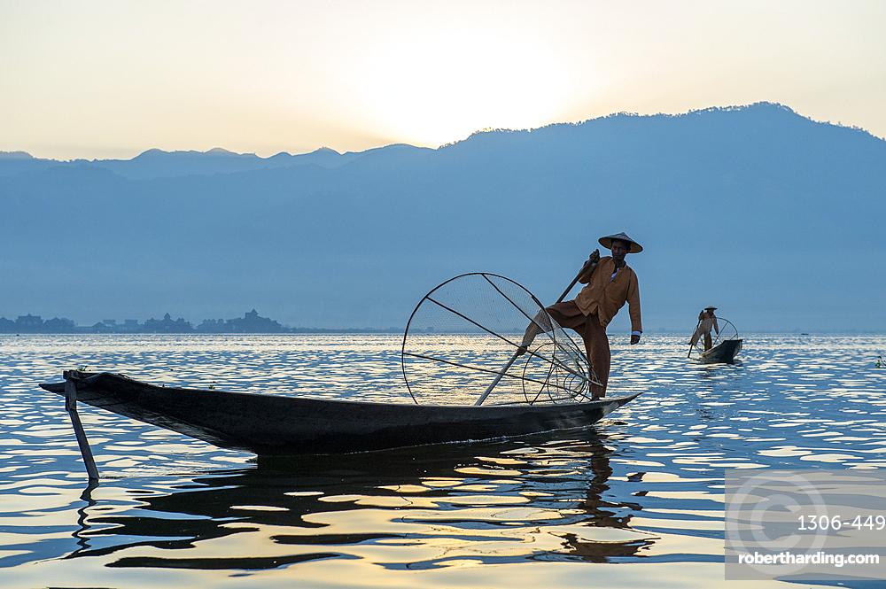 Intha leg rowing fisherman fishing, Inle Lake., Shan State, Myanmar