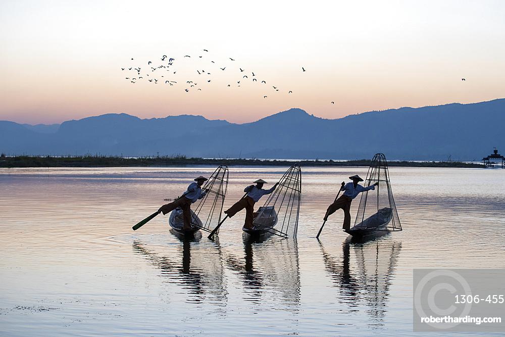 Three Intha Leg rowers on Inle Lake, Shan State, Myanmar