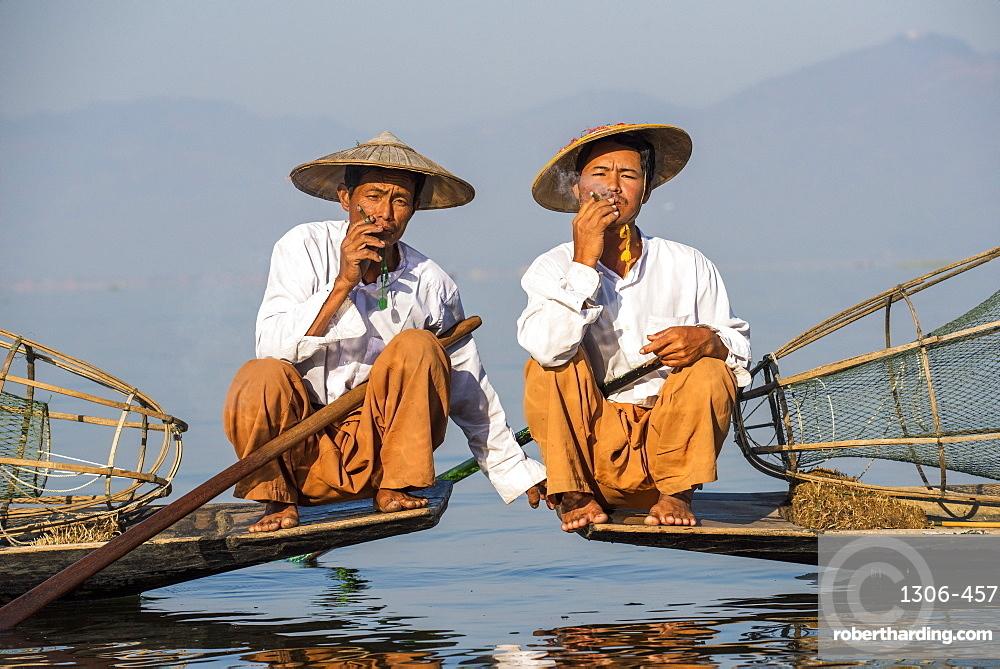 Two Intha leg rowing fishermen smoking cigars, Inle Lake, Shan State, Myanmar