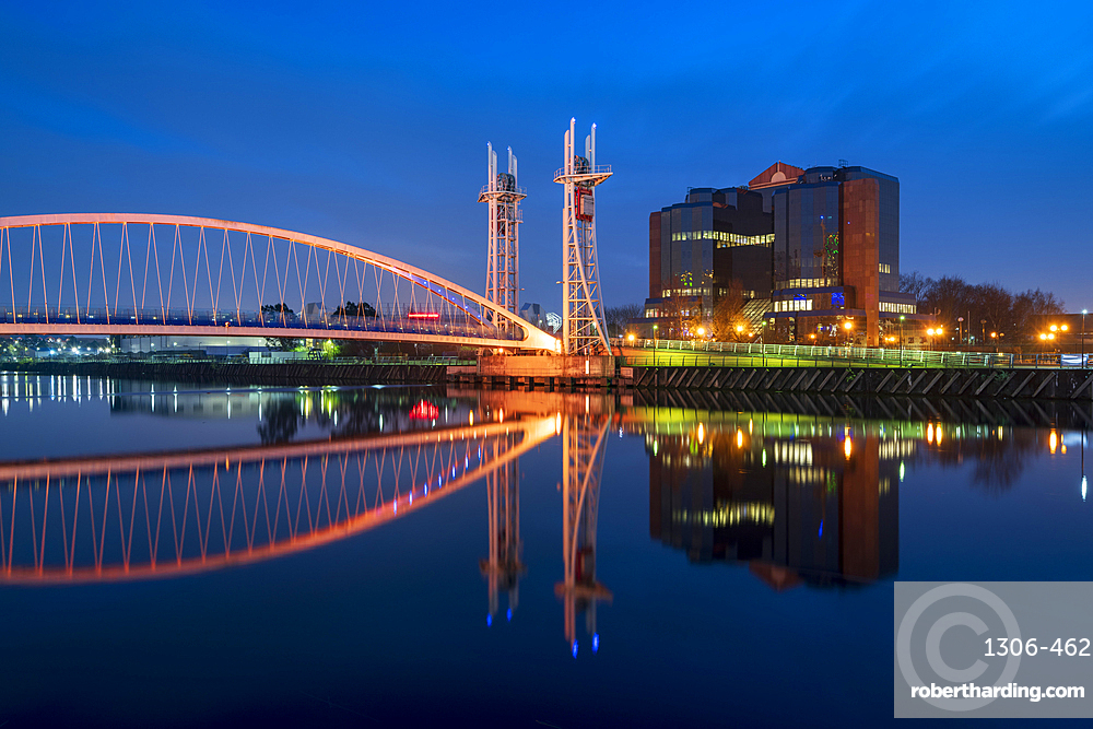 The Footbridge reflected in the River Irwell at night, Salford Quays, Manchester UK