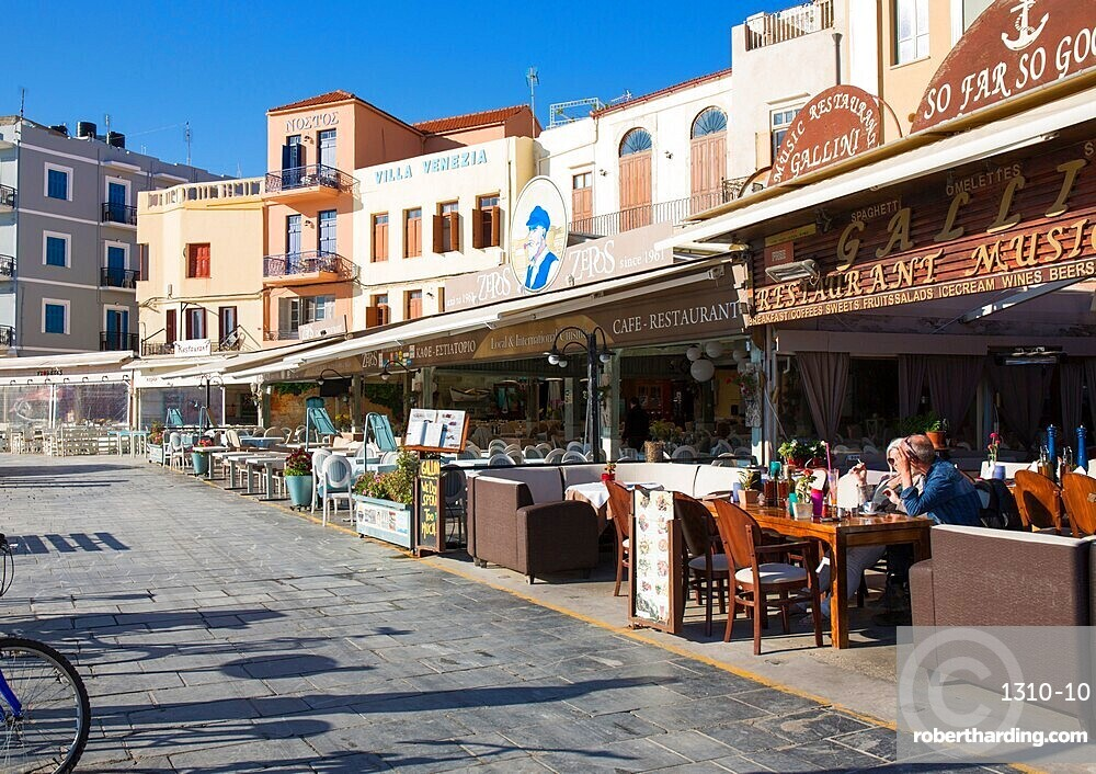 Colourful waterfront cafes and hotels beside the Venetian Harbour, Hania, aka Chania, Crete, Greece