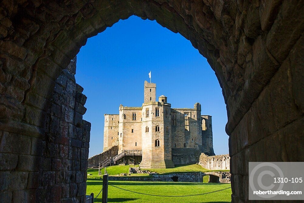 View through arch across lawns to the Great Tower of Warkworth Castle, Warkworth, Northumberland, England, UK