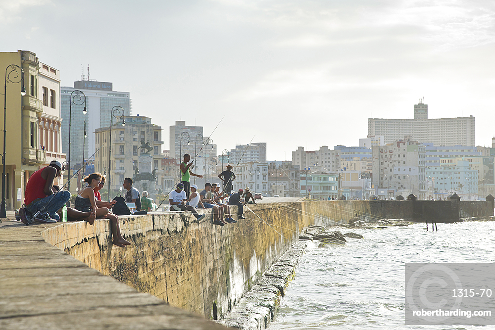 Fishing along the Malecon in Havana, Cuba, in the late afternoon.
