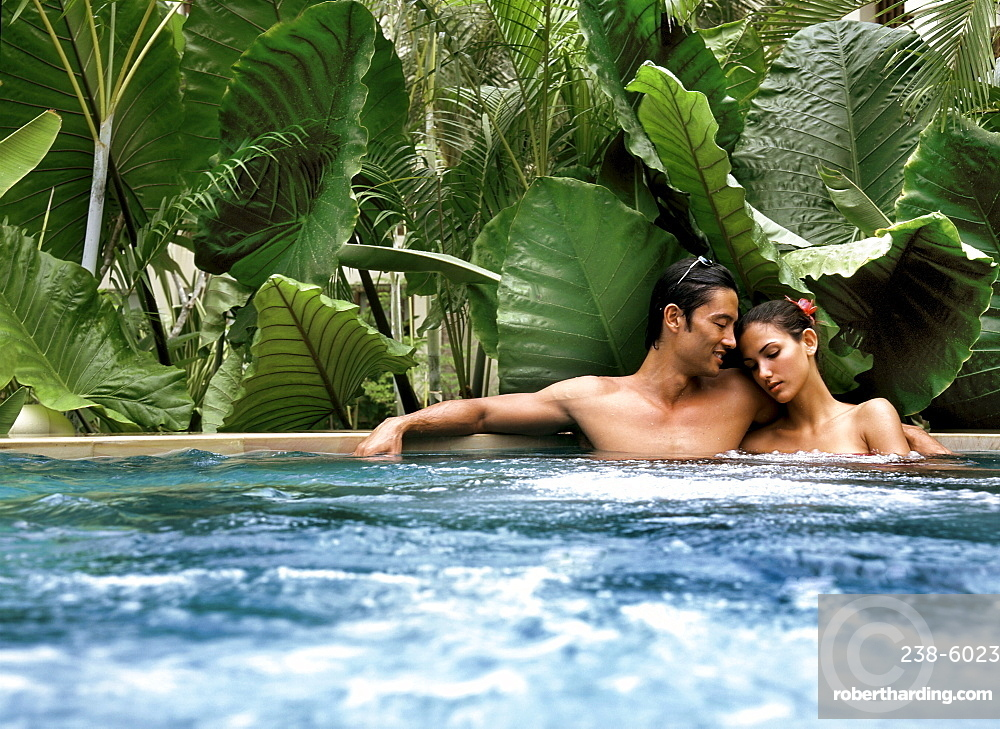 Couple in a jacuzzi, Maldives, Indian Ocean, Asia
