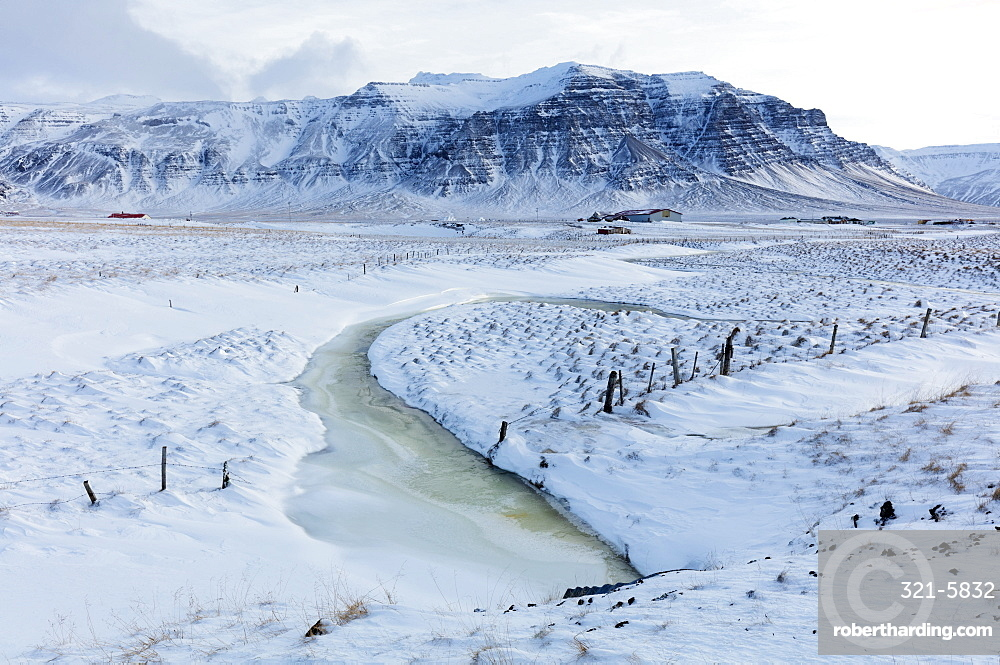 Stunning snow covered winter landscape bathed in afternoon sunlight, on the road to the Snaefellsnes Peninsula, Iceland, Polar Regions
