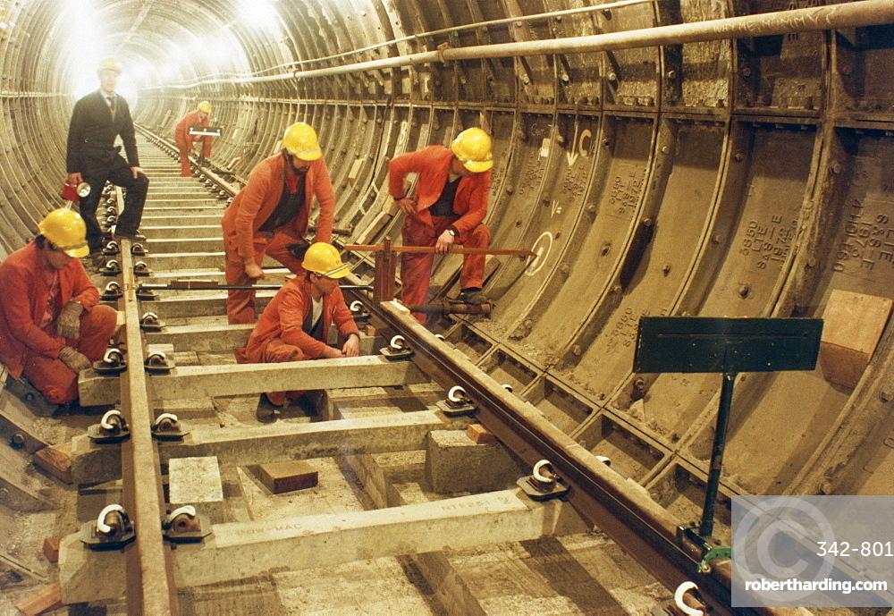 London Transport workers installing track in new tunnel loop, Terminal 4, Heathrow, London, England, United Kingdom, Europe