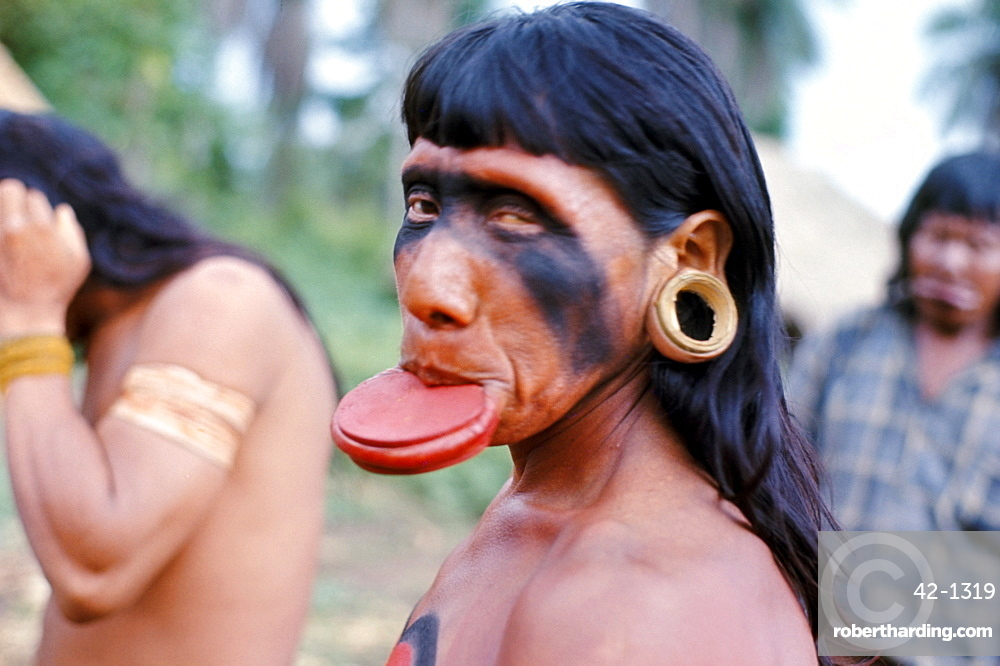 Portrait of a Suya Indian man with lip plate, Brazil, South America (1971)