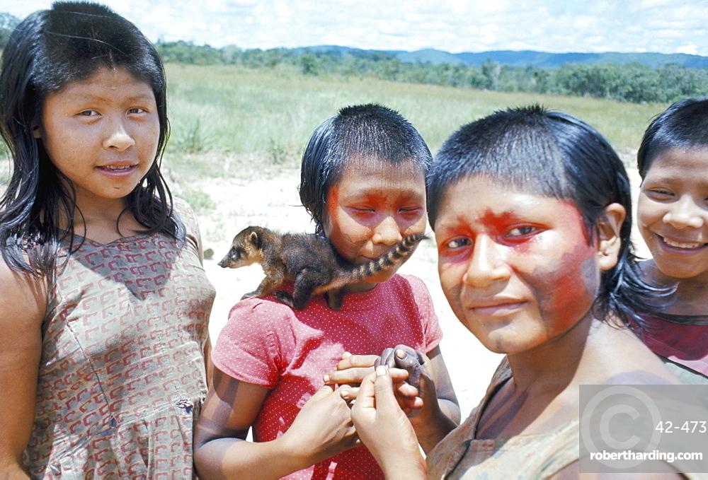 Gorotire Indian girls with coati, Brazil, South America