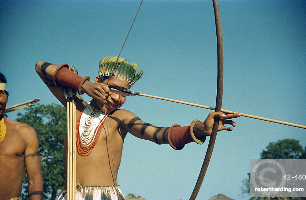 Portrait of a Karaja Indian boy with bow and arrow at Bananal, Brazil, South America
