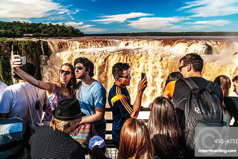 Selfie takers at the Garganta del Diablo (Devil's Throat), Iguazu Falls, UNESCO World Heritage Site, Iguazu, Argentina, South America