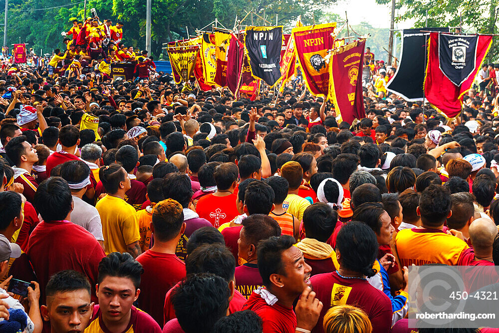 Flag carriers lead final procession of the Black Cross and Jesus at annual Feast of the Black Nazarene across Manila, Philippines, Southeast Asia, Asia