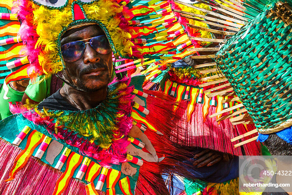 Cool participant in dark glasses and flamboyant coloured dress at the annual Ati-Atihan Festival, Kalibo Island, Philippines, Southeast Asia, Asia