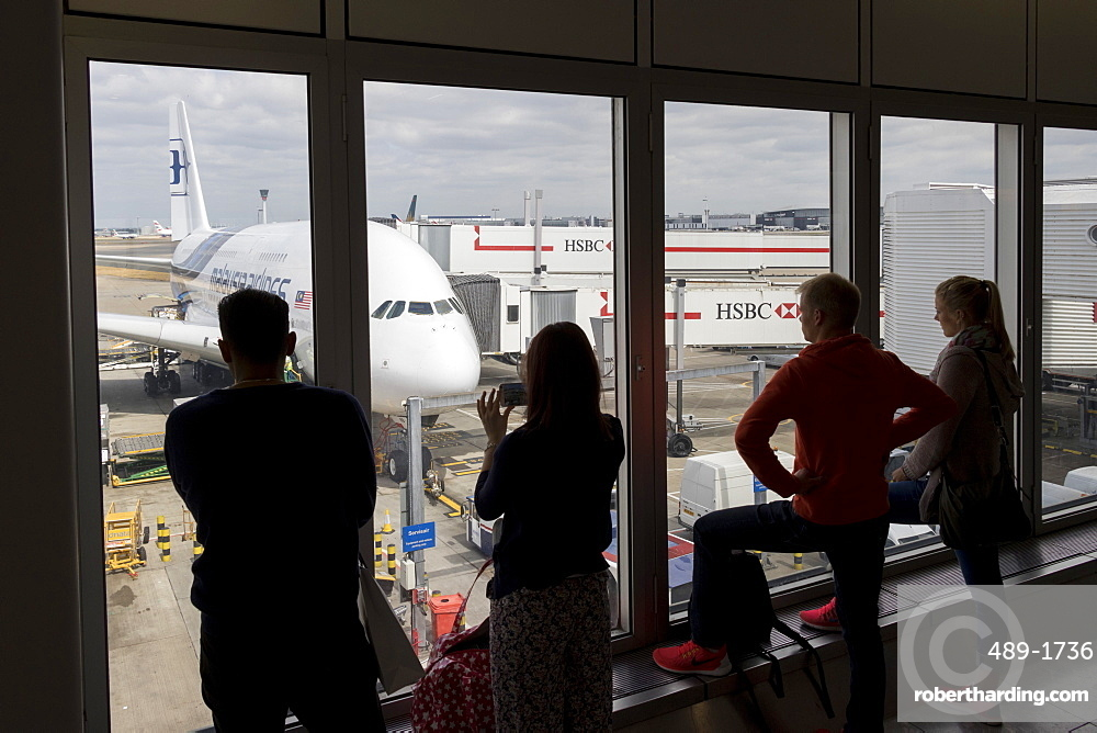 People looking through a window at an Airbus A380 of Malaysia Airlines at Kuala Lumpur International Airport, Malaysia, Southeast Asia, Asia