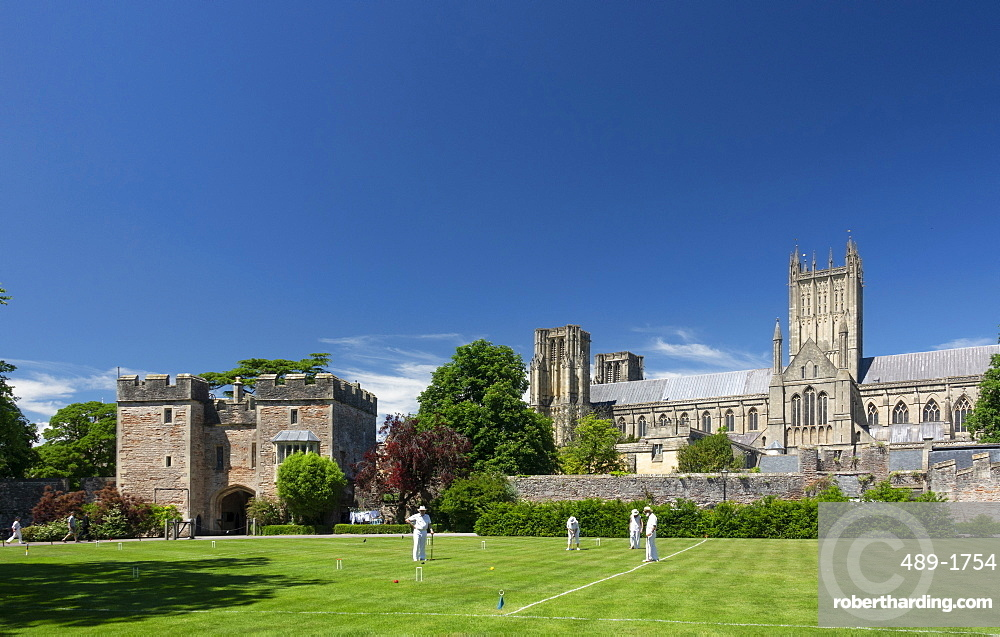 Wells Cathedral from Bishops Palace with croquet game, Wells, Somerset, England, United Kingdom, Europe