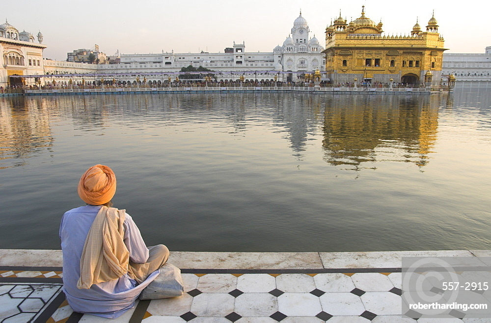 Sikh pilgrim sitting by holy pool, Golden Temple, Amritsar, Punjab state, India, Asia
