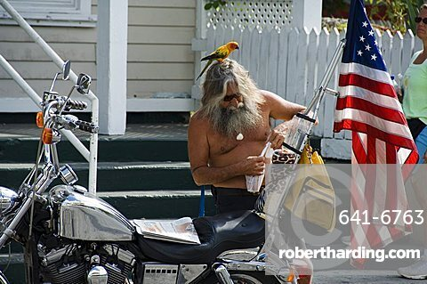 Motorcyclist with bird on head, Duval Street, Key West, Florida, United States of America, North America