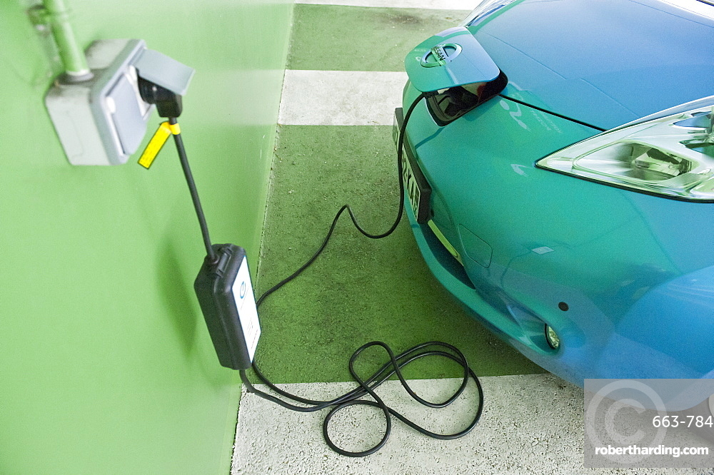 A Nissan Leaf Electric Car being charged at a Car Park in Annecy, France, Europe