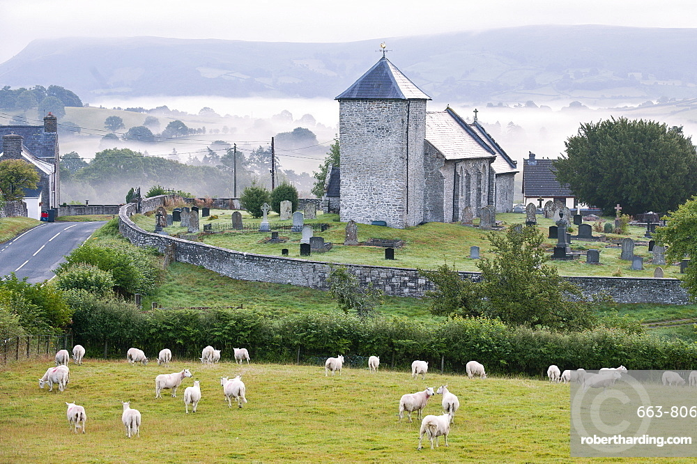 Early morning mist in the valleys surrounds St. David's Church, Llanddewi'r Cwm, Powys, Wales, United Kingdom, Europe