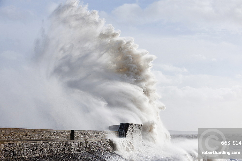 Waves crash against the harbour wall at Porthcawl, Bridgend, Wales, United Kingdom, Europe