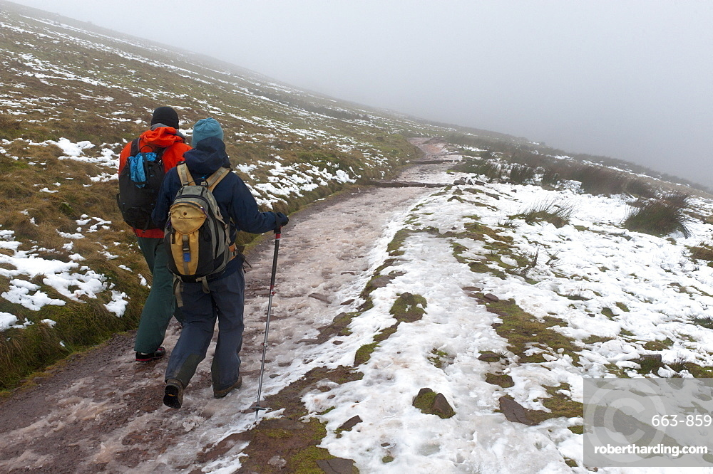 Hikers descend from Pen-Y-Fan summit in The Brecon Beacons National Park, Powys, Wales, United Kingdom, Europe