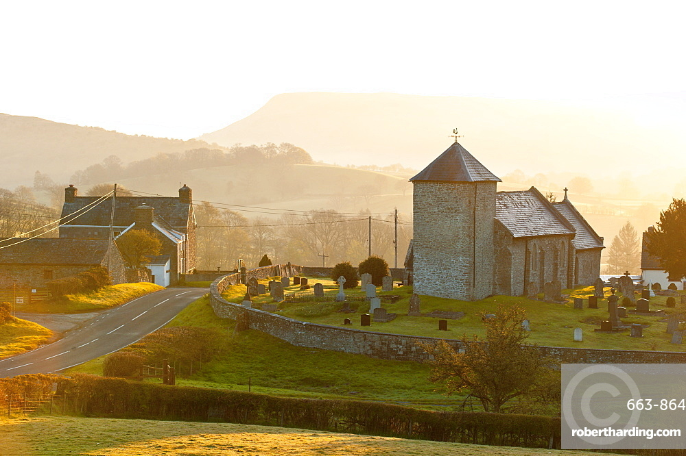 A view at sunrise of St. David's Church in the tiny hamlet of Llanddewi'r Cwm, Powys, Wales, United Kingdom, Europe