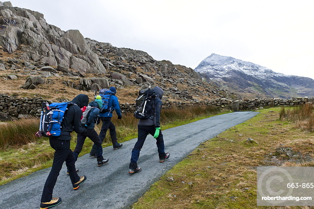Hikers set off from Pen Y Pass in winter to climb Mount Snowdon in Snowdonia National Park, Gwynedd, Wales, United Kingdom, Europe