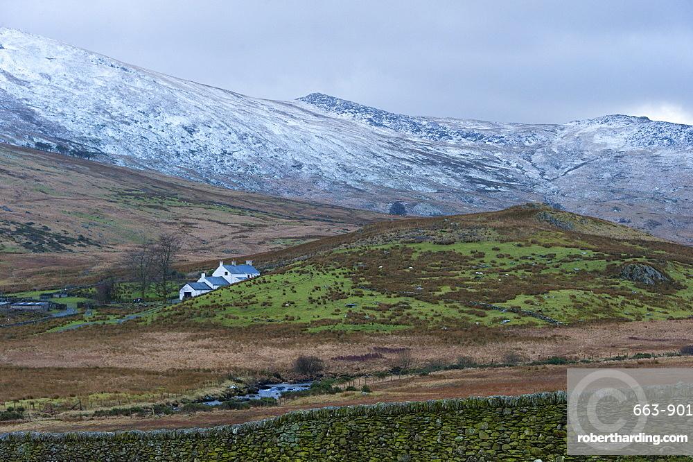 Farmhouse in a wintry landscape in the Snowdonia National Park, Gwynedd, Wales, United Kingdom, Europe