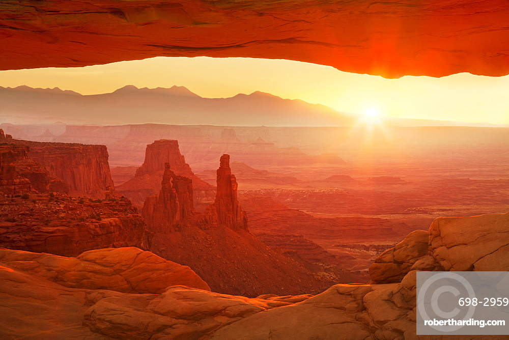 Sunrise over La Sal Mountains, Washer Woman Arch, and Mesa Arch, Island in the Sky, Canyonlands National Park, Utah, United States of America, North America