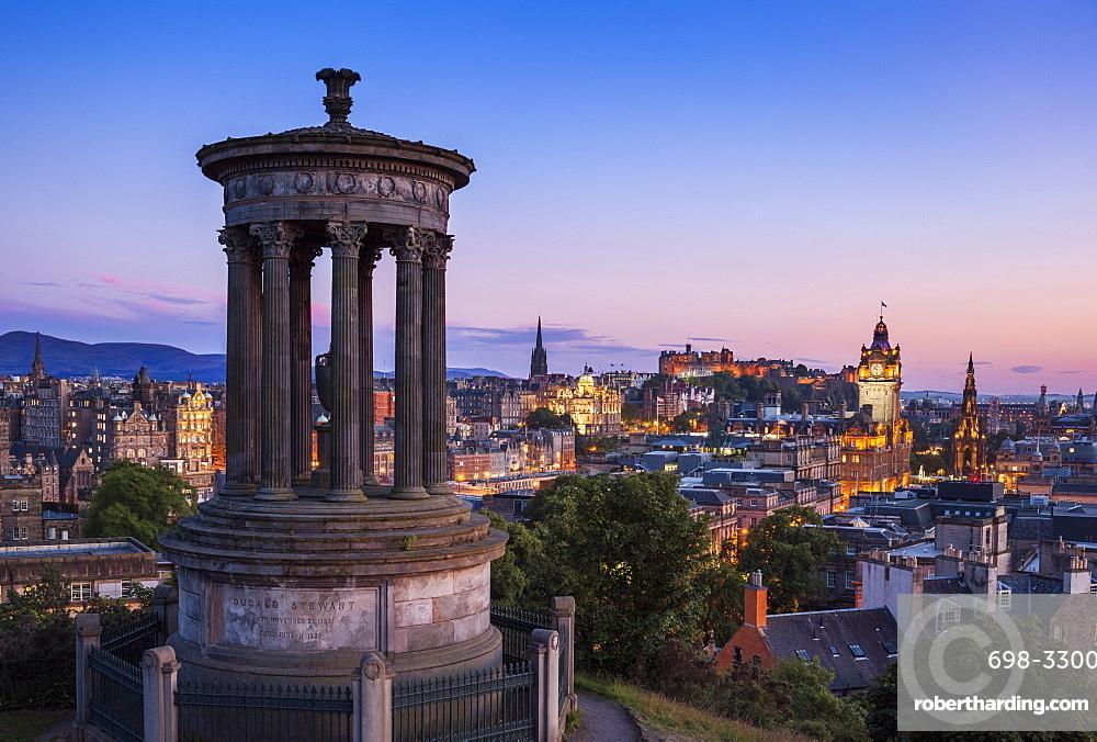 Dugald Stewart Monument, city centre and Edinburgh skyline at sunset, Calton Hill, Edinburgh, Midlothian, Scotland, United Kingdom, Europe