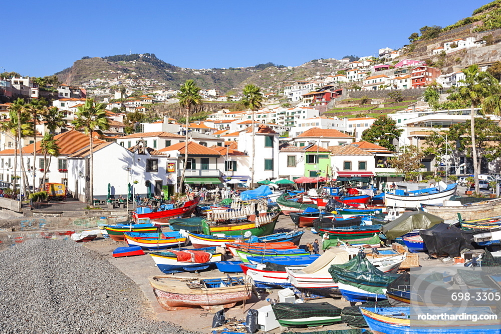 Traditional, colourful, decorated fishing boats on the beach in Camara de Lobos fishing village, Madeira, Portugal, EU, Europe