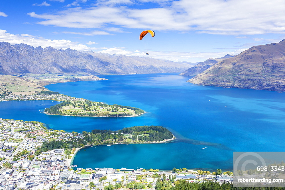 Aerial view of Queenstown, paraglider, Lake Wakatipu and The Remarkables mountains, Queenstown, Otago, South Island, New Zealand, Pacific