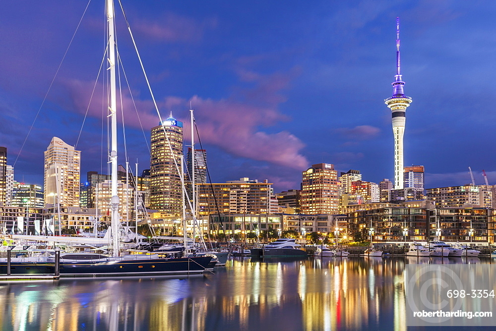 Viaduct Harbour waterfront area and Auckland Marina at night, Auckland skyline, Sky Tower, Auckland, North Island, New Zealand, Pacific