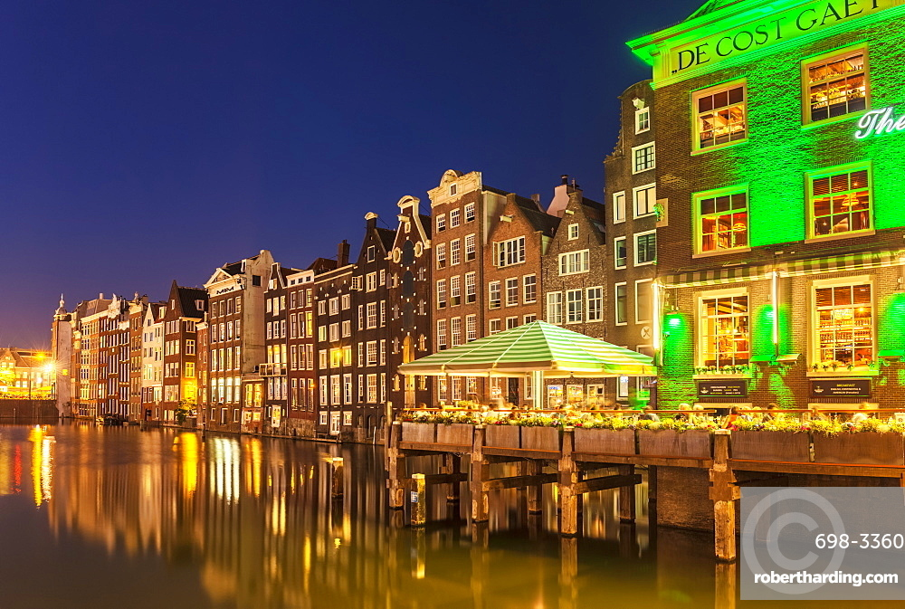 The Grasshopper steakhouse on Oudebrugsteeg Damrak canal with typical dutch houses, central Amsterdam, North Holland, Netherlands, Europe