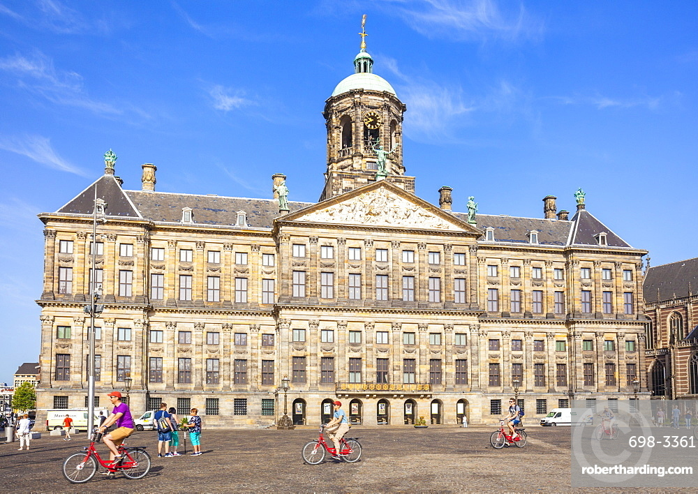 Amsterdam Royal Palace (Koninklijk Paleis) in Dam Square with cyclists, central Amsterdam, North Holland, Netherlands, Europe